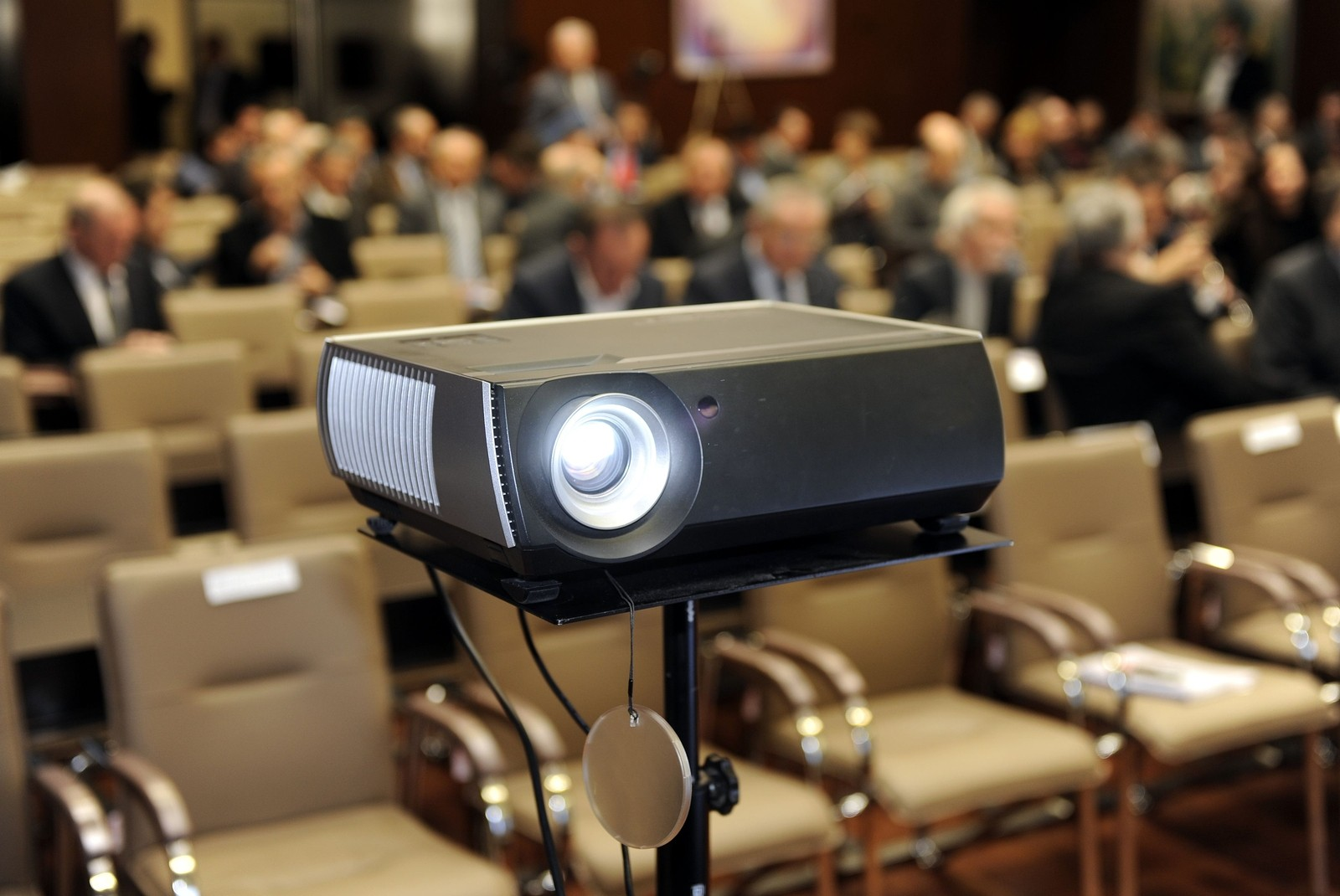 Business people attends presentation on screen projector ** Note: Shallow depth of field ** Note: Visible grain at 100%, best at smaller sizes